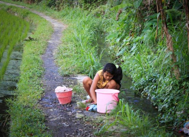 village girl, washing, Ubud